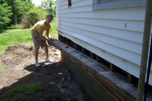 Hire a professional to jack up a house to replace with sill